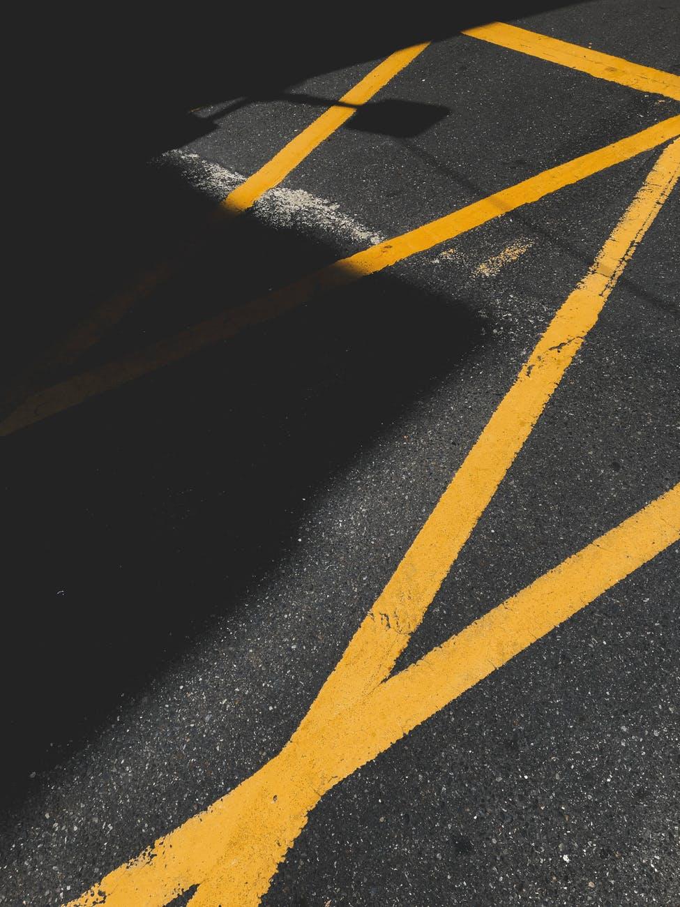 asphalt road with yellow lane